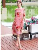 Abito sotto al ginocchio in Seta rosa con fantasia floreale