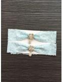 Giarrettiera celeste con gioiello pendente