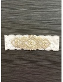 Giarrettiera Sposa di merletto bianco con decoro in strass